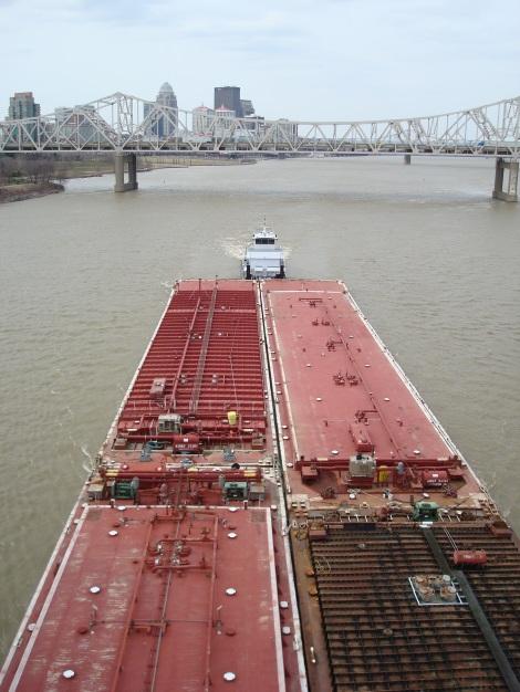 A barge passing beneath the Big Four Bridge