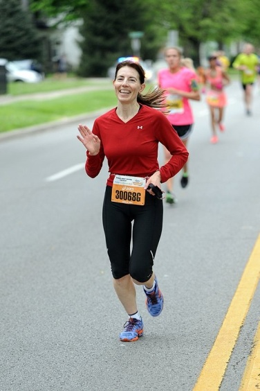Tammy running a relay leg at the 2013 Kentucky Derby Marathon